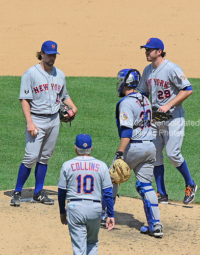 New York Mets pitcher R.A. Dickey (43) awaits the arrival of manager Terry Collins (10) to be replaced in the eighth inning against the Washington Nationals at Nationals Park in Washington, D.C. on Thursday, July 19, 2012.  Dickey and Collins are joined on the mound by catcher Josh Thole (30) and first baseman Ike Davis (29). The Mets won the game 9 - 5..Credit: Ron Sachs / CNP.(RESTRICTION: NO New York or New Jersey Newspapers or newspapers within a 75 mile radius of New York City)