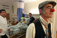 """Cris L'ariste an Israeli  medical clown who works in Hadassah and he is a member of a group call """"Dream Doctor"""", plays with Adham Takatka, 6, a Palestinian boy from the village of Marak Mu' Ala in the Bethlehem district, West Bank. Adham had a transplant of bone marrow received from his young brother Mohammed in the Hadassah Hospital.  Adham has blood tests twice a week in Hadasssah. Photo by Quique Kierszenbaum."""