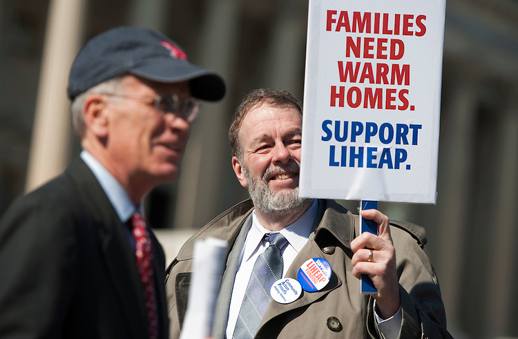 UNITED STATES - FEBRUARY 15:  Rep. Peter Welch, D-Vt., left, and Don Mathis of Community Action Partnership, prepare for a news conference at the house triangle on the effort to find funding for the Low Income Home Energy Assistance Program (LIHEAP).  (Photo By Tom Williams/CQ Roll Call)