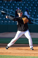 Matt Davidson (22) of the Charlotte Knights makes a throw to second base during infield practice prior to the game against the Gwinnett Braves at BB&T Ballpark on April 16, 2014 in Charlotte, North Carolina.  The Braves defeated the Knights 7-2.  (Brian Westerholt/Four Seam Images)