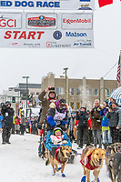 Jessie Royer and team leave the ceremonial start line with an Iditarider and handler at 4th Avenue and D street in downtown Anchorage, Alaska on Saturday March 7th during the 2020 Iditarod race. Photo copyright by Cathy Hart Photography.com