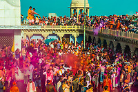 Large crowds celebrating Lathmar Holi in the village of Nandgaon, near Mathura, during Holi (festival of colors), Uttar Pradesh, India.