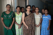 Dr. Nayna Patel poses for a photograph with other surrogate mothers at her clinic, Akanksha Infertility and IVF Clinic in Anand, Gujarat, India. The centre has become the most popular clinic for outsourcing pregnancies by western couples.
