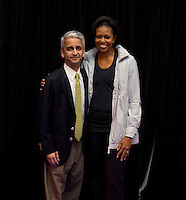 First Lady Michelle Obama stands with US Soccer Federation President Sunil Gulati during a US Soccer Foundation clinic held at City Center in Washington, DC.