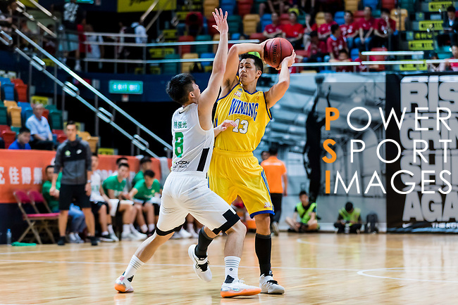 Joe Glen Matthew #13 of Winling Basketball Club handles the ball against the Tycoon during the Hong Kong Basketball League playoff game between Tycoon and Winling at Queen Elizabeth Stadium on July 27, 2018 in Hong Kong. Photo by Yu Chun Christopher Wong / Power Sport Images