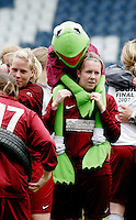 09 MAY 2007 - LONDON, GBR - Jessica Burton carries mascot Kermita as Loughborough University players celebrate their victory over Brighton University in the BUSA Womens Football Championships (PHOTO (C) NIGEL FARROW)