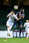 FC Kitchee Forward Alexander Akande (r) fights for the ball with FC Hanoi Defender Alvaro Silva (l) during the AFC Champions League 2017 Preliminary Stage match between  Kitchee SC (HKG) vs Hanoi FC (VIE) at the Hong Kong Stadium on 25 January 2017 in Hong Kong, Hong Kong. Photo by Marcio Rodrigo Machado/Power Sport Images