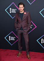 LOS ANGELES, CA. November 11, 2018: Dominic Sherwood at the E! People's Choice Awards 2018 at Barker Hangar, Santa Monica Airport.<br /> Picture: Paul Smith/Featureflash