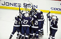 The Penn State men's hockey team celebrates their 3-2 overtime victory over Wisconsin on Monday at the Kohl Center in Madison