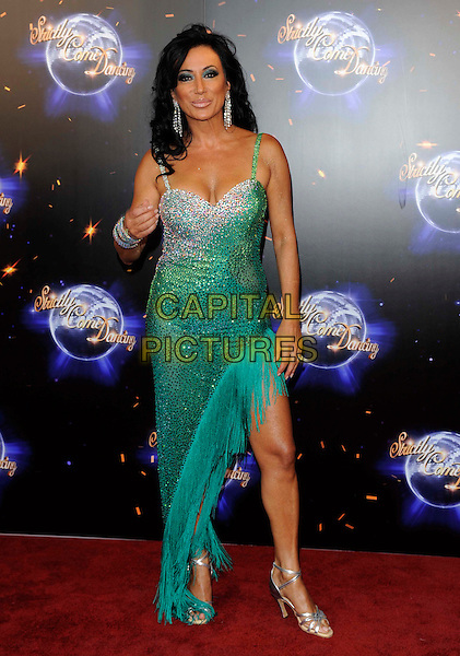 NANCY DELL'OLIO.'Strictly Come Dancing' Launch Event at BBC Studios, London, England..September 7th 2011.full length green dress silver beads beaded fringed tassels .CAP/FIN.©Steve Finn/Capital Pictures.