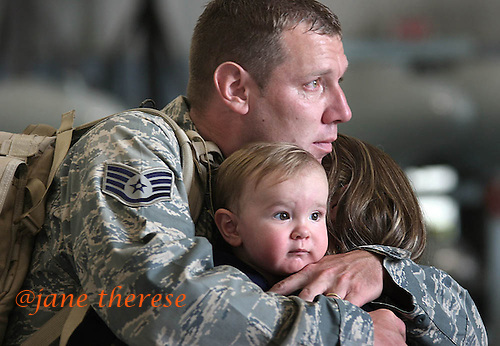 "Senior Airman Jason Koder of Northampton, Pa., hugs his 13 month old son Zander and wife Christa, prior to boarding for Afghanistan at Willow Grove Naval base in Willow Grove, Pa., on Sunday July 27, 2008. This is Koder's 3rd deployment to the Middle East. ""Leaving the family is hard,"" said Koder, ""but this is what we signed up for."" Koder was part of the 913th which disbanded last year and is now with the 111th Fighter Wing Penn Air National Guard. Photo by Jane Therese"
