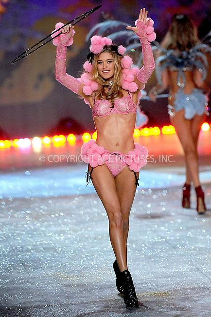 WWW.ACEPIXS.COM . . . . . .November 7, 2012...New York City....Doutzen Kroes walks the runway during the 2012 Victoria's Secret Fashion Show at the Lexington Avenue Armory on November 7, 2012 in New York City ....Please byline: KRISTIN CALLAHAN - ACEPIXS.COM.. . . . . . ..Ace Pictures, Inc: ..tel: (212) 243 8787 or (646) 769 0430..e-mail: info@acepixs.com..web: http://www.acepixs.com .