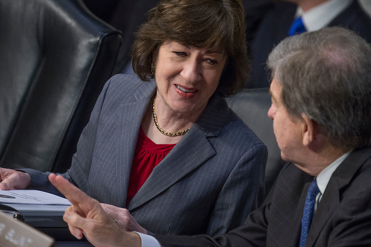 "UNITED STATES - MAY 11: Sens. Susan Collins, R-Maine, and Roy Blunt, R-Mo., prepare for a Senate (Select) Intelligence Committee hearing in Hart Building titled ""World Wide Threats"" on May 11, 2017. (Photo By Tom Williams/CQ Roll Call)"