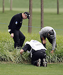 SUZHOU, CHINA - APRIL 15:  Alastair Forsyth of Scotaland and Leigh McKechnie of Australia look for a lost ball on the 18th hole during the Round One of the Volvo China Open on April 15, 2010 in Suzhou, China. Photo by Victor Fraile / The Power of Sport Images