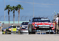 Nov. 15, 2008; Homestead, FL, USA; NASCAR Sprint Cup Series driver Carl Edwards (99) leads Dale Earnhardt Jr (88) and Jimmie Johnson (48) out of the garage during practice for the Ford 400 at Homestead Miami Speedway. Mandatory Credit: Mark J. Rebilas-