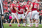 Wisconsin Badgers kicker Rafael Gaglianone (27) celebrates a field goal with teammates during an NCAA College Big Ten Conference football game against the Purdue Boilermakers Saturday, October 14, 2017, in Madison, Wis. The Badgers won 17-9. (Photo by David Stluka)