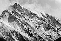 Telephoto lens closeup of a snow-capped peak in Denali National Park, as the clouds release.