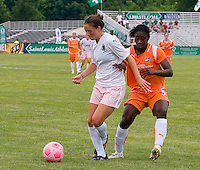 St Louis Athletica forward Kerri Hanks (2) keeps the ball in front of Sky Blue FC defender Anita Asante (5) during a WPS match at Anheuser-Busch Soccer Park, in St. Louis, MO, June 7, 2009. Athletica won the match 1-0.