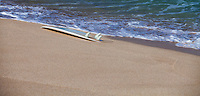Surfboard laying on the Sand