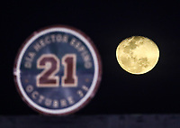 The Moon is seen beside the number 21 retired in honor of Hector Espino, during the Caribbean Series baseball game as the match of the Tomateros of Culiacan de Mexico against the Criollos de Caguas of Puerto Rico Charros de Jalisco baseball stadium in Guadalajara, Mexico, Friday, February 2, 2018. (AP Photo / Luis Gutierrez)