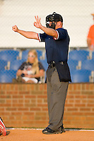 Home plate umpire Jonathan Bailey indicates the count is 3-0 during an Appalachian League game between the Burlington Royals and the Johnson City Cardinals at Howard Johnson Stadium June 27, 2009 in Johnson City, Tennessee. (Photo by Brian Westerholt / Four Seam Images)