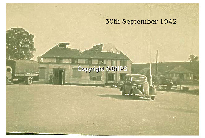 BNPS.co.uk (01202 558833)<br /> Pic: CorinMesser/BNPS<br /> <br /> The St George and Dragon pub after the plane crashed into to it. Sergeant Albert Stilin, of 257 Squadron, was killed aged 21 when he crashed his Hurricane into this pub's roof on September 30, 1942. Another airman later put the initials 'RIP' put after his name.<br /> <br /> Sections of a torn-down pub ceiling which are covered in 250 signatures from World War Two heroes have been salvaged and turned into a memorial.<br /> <br /> The merry airmen left their mark during raucous evenings at the George and Dragon in the village of Clyst St George in Devon.<br /> <br /> Many of the brave men who signed or drew on the wood ceiling perished in the war in the skies with the Luftwaffe.<br /> <br /> The ceiling was taken down in 1975 and half of it was destroyed. <br /> <br /> Robin and Suzannah Holwell recovered the surviving planks from a RAFA association store room in 2009 and have carried out a decade-long preservation project, putting the sections in frames and researching the men behind signatures.