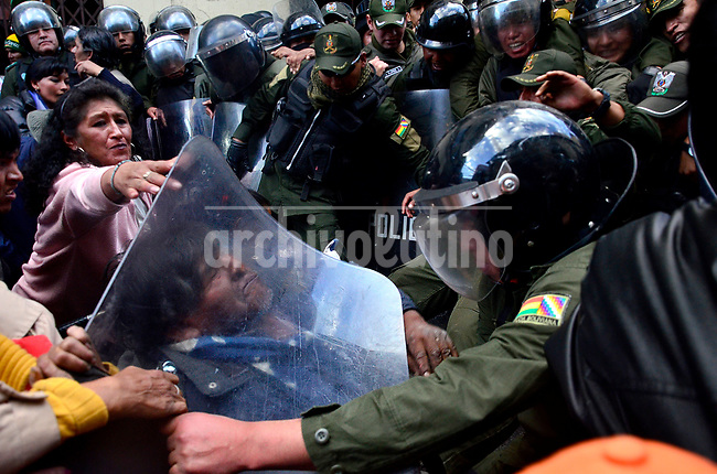 Clashes between police and handicapped people demanding a minimum wage as subsidy from the government