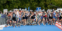 15 AUG 2009 - LONDON, GBR - As the lead pack enters transition Alistair Brownlee (centre, holding bike) manages to keep his balance when Laurent Vidal falls in front of him - ITU World Championship Series Mens Triathlon (PHOTO (C) NIGEL FARROW)