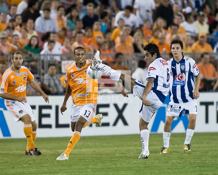 Pachuca FC midfielder Jaime Correa (6) gets a foot on the ball in front of Houston Dynamo midfielder Ricardo Clark (13).  Houston Dynamo defeated Pachuca FC 2-0 in the semifinals of the Superliga 2008 tournament at Robertson Stadium in Houston, TX on July 29, 2008.