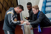 Re: Saturday 21st March 2015 <br /> Pictured: Jordi Amat of Swansea City  signs autographs for fans prior to the game at villa park <br /> Re: Barclays Premier League Aston Vila v Swansea City at Villa Park, Birmingham, UK