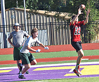 RICK PECK/SPECIAL TO MCDONALD COUNTY PRESS McDonald County's John Howard catches a touchdown pass from Cole Martin during the Mustangs' 7-on-7 scrimmage against Mount Vernon on June 10 at Monett High School.