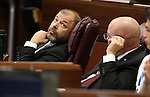 Nevada Assembly Republicans Paul Anderson, left, and Ira Hansen watch the final minutes of the session tick away at the Legislative Building in Carson City, Nev., on Monday, June 1, 2015. <br /> Photo by Cathleen Allison