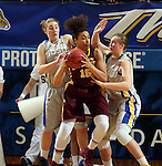 BROOKINGS, SD - MARCH 27:  Chynna Stevens #0 and Clarissa Ober #21 from South Dakota State University double team Micaëlla Riché #15 from the University of Minnesota in the first half of their sweet sixteen gameThursday night at Frost Arena in Brookings. (Photo by Dave Eggen/Inertia)