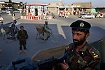 An Afghan National Army soldier surveys a main street from the gun turret of an armored vehicle in the city of Kandahar, Afghanistan, Aug. 19, 2009. The Afghan National Police and Army stepped up their presence in the city ahead of the Aug. 20 presidential election.