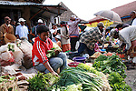 Young woman selling salad and leek at the Analakely market in Antananarivo in Madagascar