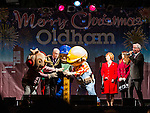 © Joel Goodman - 07973 332324 . 17 November 2013 . Oldham , UK . Bob the Builder franchise and mayor press the button to turn on the lights as compère Jeffrey Longmore counts down from the side of the stage . The Christmas lights are turned on in Oldham Town Centre . Photo credit : Joel Goodman