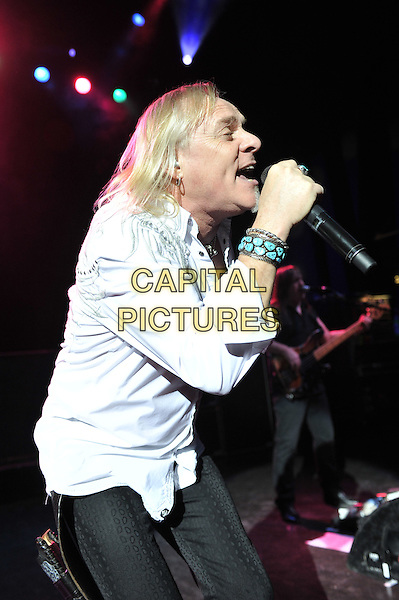 Bernie Shaw.Uriah Heep performing live in concert, Shepherd's Bush Empire, London, England. .8th December 2011.on stage gig performance music half length white shirt singing side profile .CAP/MAR.© Martin Harris/Capital Pictures.