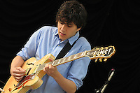 Guitarist and lead vocalist Ezra Koenig of Brooklyn NY based indie alt rockers Vampire Weekend performs at Summer Stage in Central Park NYC ( June 14, 2008)