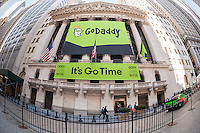 The New York Stock Exchange decorated for the first day of trading for the GoDaddy IPO on Wednesday, April 1, 2015. The 18 year-old technology company registers domain names, hosts websites and provides an assortment of technology services to individuals and small businesses. (© Richard B. Levine)