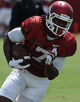 NWA Democrat-Gazette/ANDY SHUPE<br /> Arkansas receiver Damon Mitchell carries the ball after making a catch Saturday, Aug. 8, 2015. during practice at the university football practice field in Fayetteville.