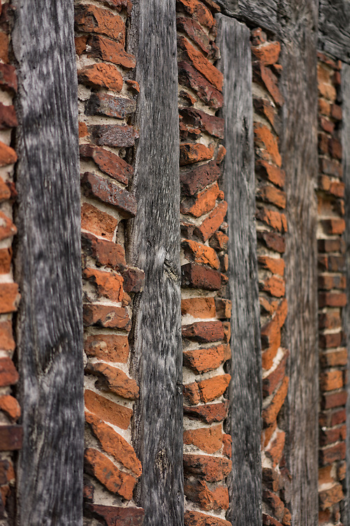 Old tudor wall constructed with red bricks and timber in winchester, England