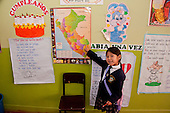 Arequipa, Peru. A. Antoniano (public elementary and secondary school). Student (girl, elementary-school aged, Peruvian) points to her country (Peru) on a poster map of South America. No MR. ID: AL-peru.