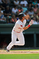 Third baseman Michael Chavis (11) of the Greenville Drive runs out a grounder in a game against the Hagerstown Suns on Sunday, July 17, 2016, at Fluor Field at the West End in Greenville, South Carolina. Hagerstown won, 3-2. (Tom Priddy/Four Seam Images)
