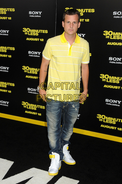 """Rob Dyrdek.""""30 Minutes or Less"""" World Premiere held at Grauman's Chinese Theatre, Hollywood, California, USA..August 8th, 2011.full length jeans denim yellow top.CAP/ADM/BP.©Byron Purvis/AdMedia/Capital Pictures."""
