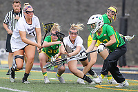 Towson, MD - March 25, 2017: Towson Tigers and Oregon Ducks players try to get the ball during game between Towson and Oregon at  Minnegan Field at Johnny Unitas Stadium  in Towson, MD. March 25, 2017.  (Photo by Elliott Brown/Media Images International)