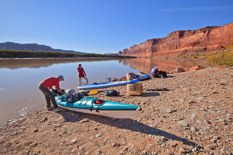 Jacque Miniuk (left) and Colleen Miniuk-Sperry pack their kayak and stand-up paddleboard respectively at the Dirty Devil launch area before departing on their four-day journey from Hite to Halls Crossing on Lake Powell in the Glen Canyon National Recreation Area, Utah.
