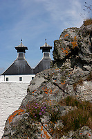 The unusual shape of the turreted roof of a whisky distillery recalls the shape of Chinese hats