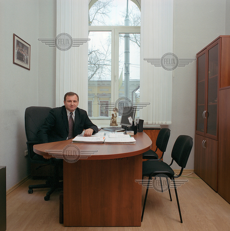 "Valery Nikolayevich Uimanov (1958) is assistant to the mayor of Tomsk.  He ensures that there is no duplication of work between local departments and the police, the prosecutor?s office, the military, the secret service (FSB, the former KGB) and the customs. He works 5 days a week from 8.30 am till 7 pm and on Saturdays from 8.30 am untill 1 pm.  He was head of the Information Department of Tomsk province before he began this job in the beginning of 2004.  He is married with a daughter and a son.  Salary: ""About 1000 dollars a month. The more money you?ve got, the more new perspectives you create to spend it."""