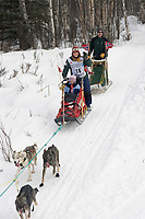 Trine Lyrek w/Iditarider on Trail 2005 Iditarod Ceremonial Start near Campbell Airstrip Alaska SC