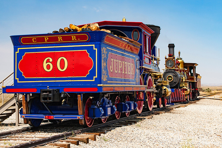 Central Pacific Railroad #60, the Jupiter, sits on the rails at Golden Spike National Historic site at Promontory Summit in Utah. On May 10, 1869, the original Jupiter along with the Union Pacific's No. 119 where placed nose to nose a railroad tie width apart during the driving of the Golden Spike that completed the Transcontinental Railroad. The original Jupiter was lost to the scrap heap and in honor of the Transcontinental Railroad's bicentennial in 1969 a reproduction of the original was made. Photographed 07/07